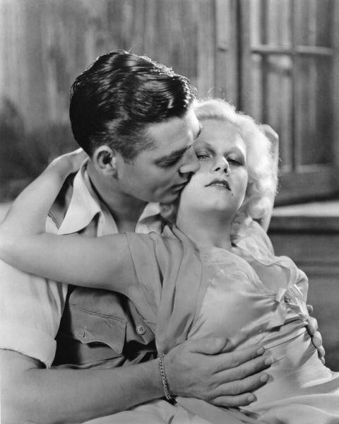 <p><strong>JEAN HARLOW, 1932</strong><p><p> Jean Harlow, the original Blonde Bombshell, was hugely popular in 1930s Pre-Code Hollywood and liked to do this thing where she wore really clingy dresses without a bra (the horror!). Here she is with Clark Gable, her co-star in Red Dust.