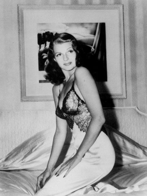 """<p><strong>RITA HAYWORTH, 1941</strong><p><p> Rita Hayworth wasn't yet known as the """"Love Goddess"""" when she sat for this alluring image for <em>LIFE</em> magazine in 1941. It became """"arguably the single most famous and most frequently reproduced American pinup image ever"""" (that's <a href=""""http://time.com/3881042/rita-hayworth-photos-of-a-movie-legend-and-all-american-pinup-girl/"""">according to <em>LIFE</em></a>, though I'm not going to disagree). She wore a lacy silk negligee — definitely inside clothes back then — and knelt on top of a bed in the photograph by Bob Landry. It was too risqué for the cover, according to <a href=""""http://www.npr.org/templates/story/story.php?storyId=1143273"""">someone who worked at <em>LIFE</em></a><em> </em>at the time, but it was fine to run inside the magazine. More than 5 million copies of the image ended up in the hands of American troops fighting in World War II."""
