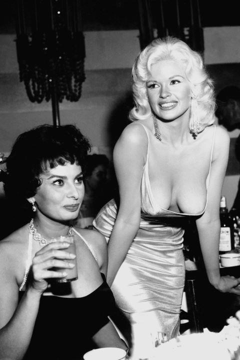 """<p><strong>JAYNE MANSFIELD, 1957</strong><p><p> There's a more famous photo than this from the same party in which Sophia Loren (pictured here on the left) gives Jayne Mansfield the <a href=""""http://www.vanityfair.com/hollywood/2014/11/story-behind-infamous-sophia-loren-jayne-mansfield-photo"""">stankiest side eye</a> ever captured. Why the contempt? Mansfield had arrived in a dress that stole the spotlight, which was supposed to be on Loren that night. (The move was a publicity stunt; Mansfield knew that the dress would expose her boobs.) """"Look at the picture,"""" <a href=""""http://www.ew.com/article/2014/11/03/sophia-loren-jayne-mansfield"""">Loren recently told <em>EW</em></a>. """"Where are my eyes? I'm staring at her nipples because I am afraid they are about to come onto my plate. In my face you can see the fear. I'm so frightened that everything in her dress is going to blow — <em>BOOM! </em>— and spill all over the table."""""""