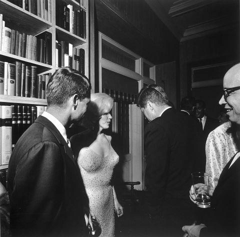 <p><strong>MARILYN MONROE, 1962</strong><p><p> Here's a closer look at the dress, which Monroe was still wearing when she hit up the after-party with President Kennedy and Robert F. Kennedy. The lore is that she skipped underwear for this dress. It might explain why the president isn't looking at the actress at all but keeping his eyes on the floor. The dress later sold at auction for $1.26 million.
