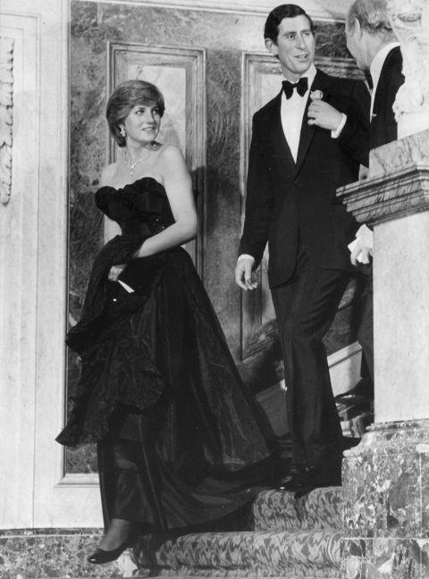 """<p><strong>LADY DIANA SPENCER, 1981</strong><p><p> Diana — who was only 19 years old at the time — wore a strapless black taffeta gown by Emanuel to her <a href=""""https://www.youtube.com/watch?v=XAvzNouZYvY"""">first public outing</a> with Prince Charles. Because it was strapless, Diana was photographed with her décolletage spilling out of the top when she was getting out of her car, and the public went nuts for Daring Di. """"We hadn't considered the fact that when Diana bent over — as she would have to do when getting out of the car — she would show quite a lot of cleavage,"""" wrote designer Elizabeth Emanual. """"We just thought she looked fabulous."""""""