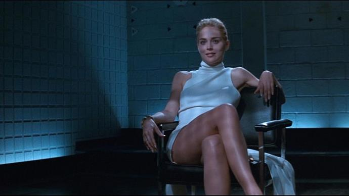 <p><strong>CINDY CRAWFORD, 1991</strong><p><p> In one of the most famous scenes in Basic Instinct, Sharon Stone wears a sleeveless turtleneck dress made of winter white wool crepe. Costume designer Ellen Mirojnick made a choice to clothe Stone's femme fatale in pale neutrals instead of dark, vampy colors. Stone famously crosses and uncrosses her legs in the white dress, exposing her uncovered genitalia. (The actress later claimed this happened without her knowledge.) The graphic sexual nature of the scene (and the film) led to protest and criticism.