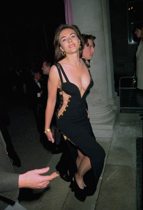 """<p><strong>ELIZABETH HURLEY, 1994</strong><p><p> No one knew who Elizabeth Hurley was when she wore a safety pin dress by Versace to accompany then-boyfriend Hugh Grant to the London premiere of Four Weddings and a Funeral. By the next day, she was world-famous. Designer Gianni Versace said afterward that Hurley gave the dress all its sexy magic. """"Liz has this intelligent face attached to that very naughty body,"""" he said. """"So seeing a woman like her in this gown is a guarantee that everyone would go pozzo [nuts]."""" For her part, Hurley doesn't quite get why the dress has so much power more than 20 years later. The public response to the dress was, for her, """"a ludicrous surprise."""""""