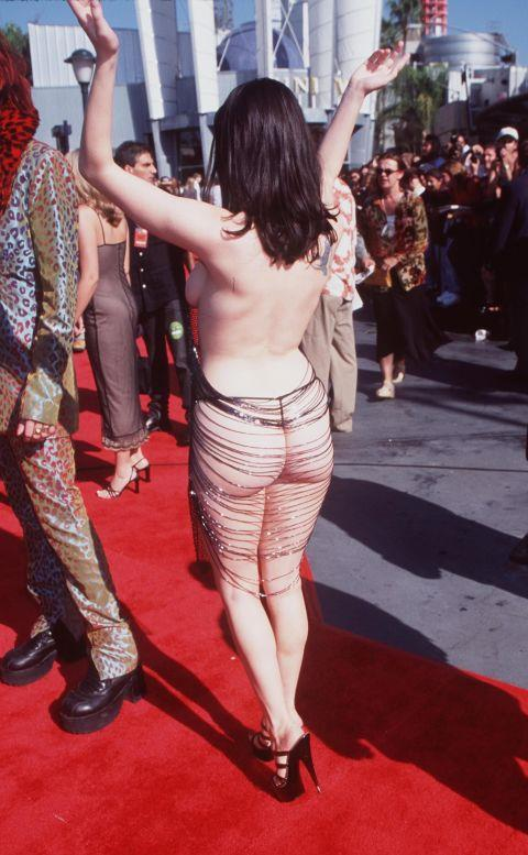 """<p><strong>ROSE MCGOWAN, 1998</strong><p><p> McGowan said that the dress """"made her laugh"""" and that it was """"punk as F."""" She had wanted it to """"cause a scene,"""" she said, and it that sense, the dress was a success."""