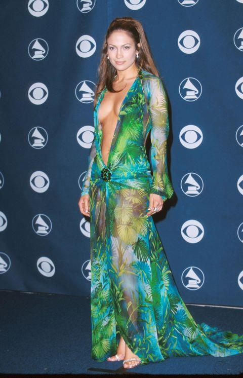 """<p><strong>JENNIFER LOPEZ, 2000</strong><p><p> Along with David Duchovny, Jennifer Lopez presented the first award at the Grammys in 2000. She wore a sheer green silk chiffon dress by Versace that had been worn previously by model Amber Valletta and Spice Girl Geri Halliwell. But nobody wore it like J.Lo. You could hear someone in the audience yell out, """"Oh my god!"""" as people cheered appreciatively. """"Well, Jennifer,"""" Duchovny said, """"this is the first time in five or six years that I'm sure that nobody is looking at me."""""""