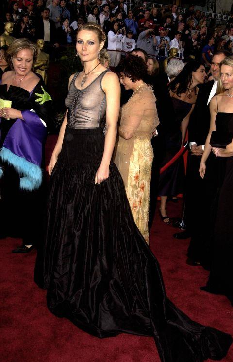 """<p><strong>GWYNETH PALTROW, 2002</strong><p><p> Gwyneth Paltrow herself called this unflattering look (but memorable precisely for this reason) a fashion faux pas. """"There were a few issues; I still love the dress itself but I should have worn a bra and I should have just had simple beachy hair and less makeup. Then, it would have worked as I wanted it to — a little bit of punk at the Oscars."""""""