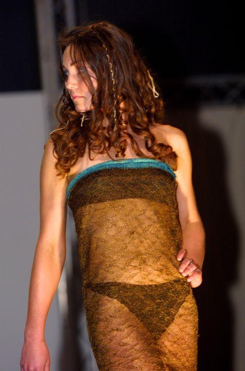 """<p><strong>KATE MIDDLETON, 2002</strong><p><p> According to CNN, the size-8 dress started out as a skirt, and was made with two turquoise bands at either end of a column of knitted black-and-gold silk. The designer said she created the dress with """"the art of seduction"""" in mind. """"So, in a way, if that's what she wanted, she definitely bagged her prince, so it got her what she wanted."""""""