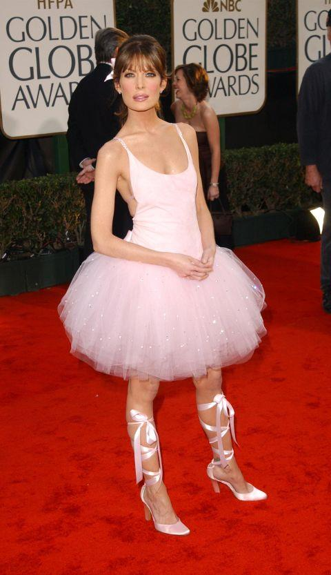 """<p><strong>LARA FLYNN BOYLE, 2003</strong><p><p> Lara Flynn Boyle had recently broken up with Jack Nicholson and attended the Golden Globes as a newly single woman. She wore a rather ill-fitting ballerina dress designed by David Cardona, who used suede for the top and silk tulle for the skirt. """"All the Europeans thought it was genius,"""" Cardona told Yahoo! in 2014."""