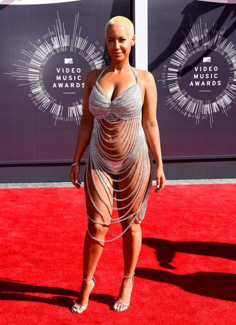 """<p><strong>AMBER ROSE, 2014</strong><p><p> Amber Rose's revealing chain metal dress by Laurel DeWitt, which she wore to the VMAs in 2014, drew comparisons to Rose McGowan's VMAs look from 1998 and yet still managed to shock people. The NYC-based DeWitt is known for her custom creations. She told the Telegraph, """"My theory behind it was to create spectacular one of a kind pieces that become so exclusive and can't be found anywhere else, so that the stylists come to me."""""""