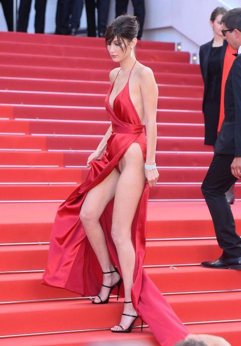 """<p><strong>BELLA HADID, 2016</strong><p><p> For our latest """"the dress,"""" we have this custom Alexandre Vauthier Couture gown worn by Bella Hadid at the Cannes Film Festival. She wasn't wearing nothing underneath, though it certainly seemed that way for most of her walk down the red carpet. And it was the possibility of exposure that really made everyone stop and stare (and click). But there were safeguards in place: """"The dress has a built-in silk bodysuit,"""" Bella's stylist Elizabeth Sulcer told Vanity Fair. """"Top-stick [tape] is always a good idea. Practice makes perfect."""""""