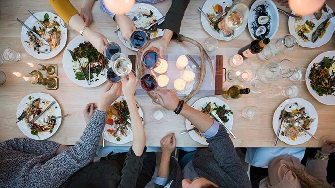 View from above friends toasting wine glasses