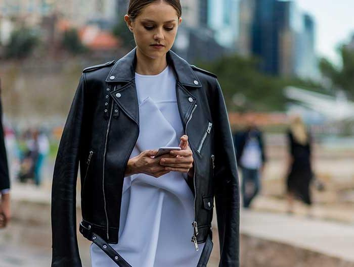 Isabelle Cornish wearing a white Toni Maticevski dress, a black Burberry leather jacket during Mercedes Benz Fashion Week Australia