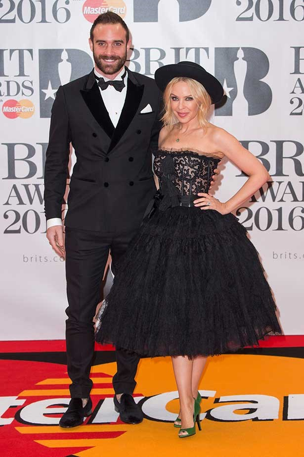 Joshua Sasse and Kylie Minogue attend the BRIT Awards 2016 at The O2 Arena on February 24, 2016 in London, England.