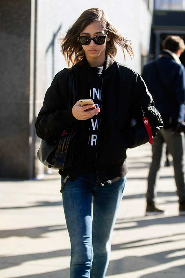 Model using phone on street