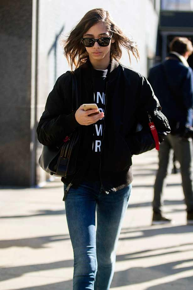 Model using phone on street
