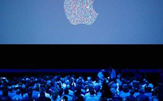 People take their seats ahead of Apple's annual Worldwide Developers Conference presentation at the Bill Graham Civic Auditorium in San Francisco, California, on June 13, 2016.