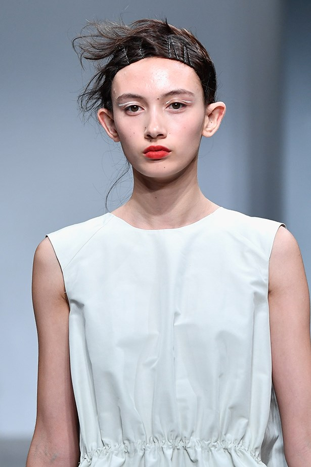 """<P>CANCER<p> <p> Cancerians are daring, creative and a little tomboy.<p> <p> While the buzzcuts seen at YSL and Versace were reserved for the brave, Akira's """"genderless"""" '90s-inspired updo made androgyny wearable for everyday.<p> <p> Sweep your hair back in a circular motion and pin, leaving a few delicate loose ends down for an undone feel."""