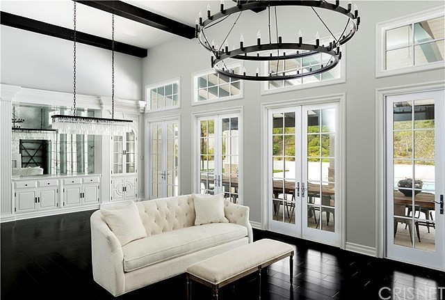 Black floorboards are a feature across the home.