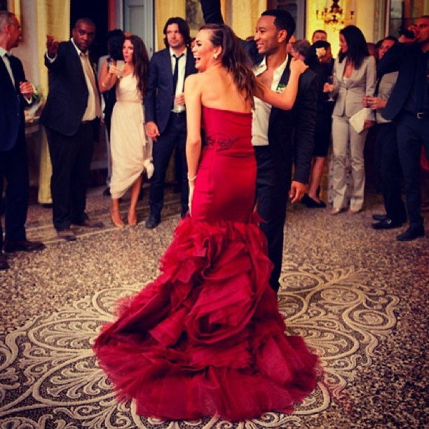 Chrissy Teigen went with this red dress for her reception.
