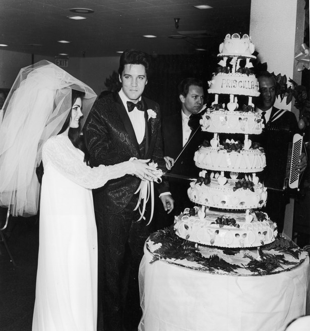 Elvis Presley's bride Priscilla wore a huge veil to go along with her simple white dress.