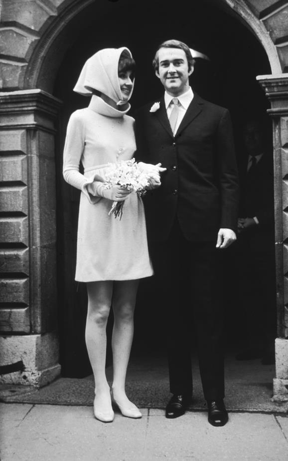 For her wedding to Andrea Dotti, Audrey Hepburn wore this pale pink woolen dress with matching headscarf by Givenchy.
