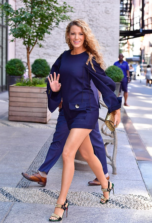 She wore this blue ensemble with studded heels for another interview.