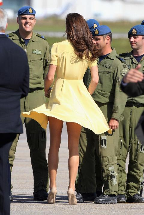 <p> <strong>PLAYING PEEKABOO</strong><p> <p> During the Cambridges' tour of Canada, Kate's floaty yellow dress got a little too floaty.