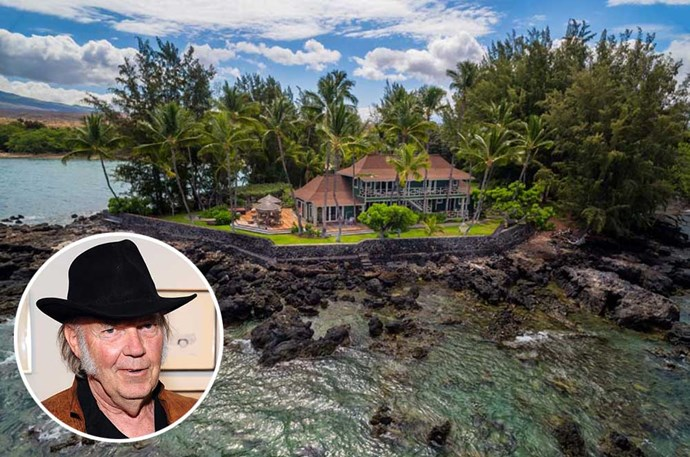 "</p><p><b>Neil Young</b></p><p> Location: Kohala, Hawaii</p><P> Canadian singer/songwriter Neil Young spent many a summer at this beautiful Hawaiian property that dates back to the 1920s. Along with a gorgeous five-bedroom main house, the property includes two guest cottages, two greenhouses, and a swimming pool. He recently sold the property for $27 million, according to <a href=""http://www.zillow.com/blog/neil-young-big-island-estate-182270/"">Zillow</a>."