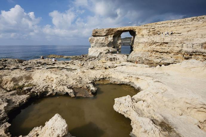 <strong>GO VISIT: AZURE WINDOW, MALTA</strong> <br><br> This natural limestone arch is located on the Maltese island of Gozo. The structures and blue waters make it a popular destination for cliff diving.