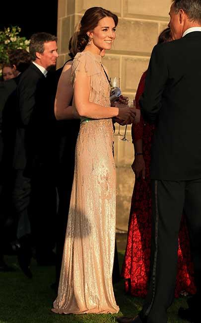 Kate has a penchant for repurposing old favourites, but she threw it way back at a gala dinner in support of East Anglia's Children's Hospices, wearing the dress she wore during her first official royal outing in 2011.