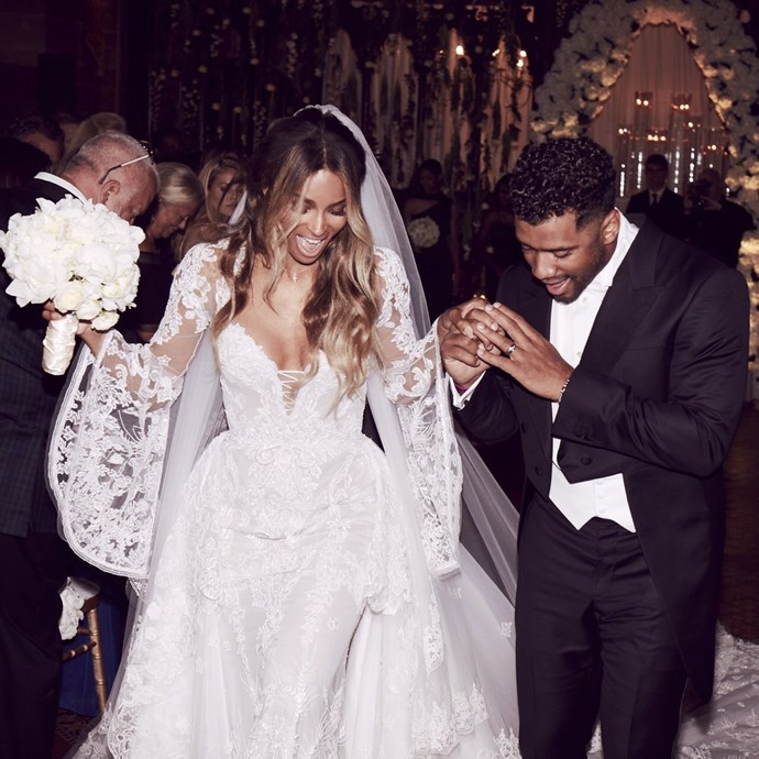 "Singer Ciara married her fiancé Russell Wilson in custom Cavalli Couture (composed of ""white silk tulle, fully embroidered with floral motifs throughout, and delicate glass beading"") this week in an old English castle in Liverpool."