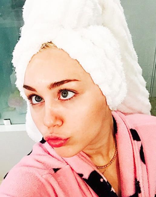 <strong>Step 2. Towel dry</strong> <br><br>Soaking wet hair adds a gazillion hours onto your blowdry time, so make like Miley and get rid of as much excess moisture as you can before you start. Gently pat your hair with your towel to absorb moisture as rubbing will rough up the cuticle and cause frizz.