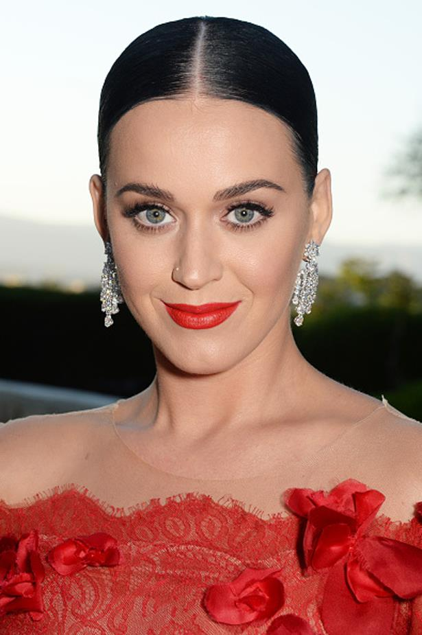 Katy's not afraid of a wild beauty trend, but she keeps it classic with a bold lip and immaculate arches at the 2016 Cannes amfAR gala.
