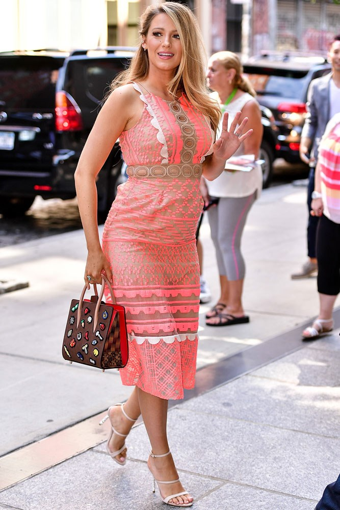 Blake earlier today in New York, in a semi-sheer pink lace Jonathan Simkhai dress.