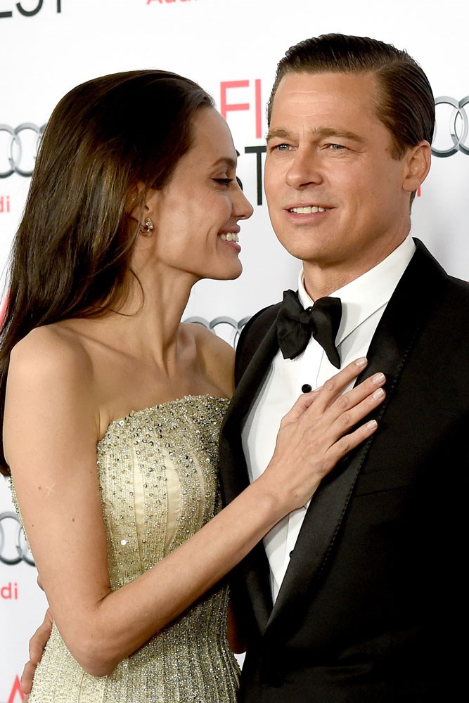 **Angelina Jolie and Brad Pitt**  Pitt admitted he fell in love with Angelina Jolie when they co-starred in *Mr. & Mrs. Smith* in 2004, but the two knew better than to get cosy in public—he was still married to Jennifer Aniston. But 12 years and six kids later, the two split in 2017.