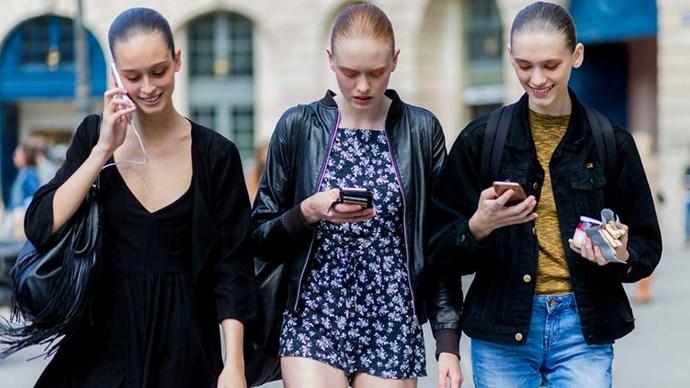 Models looking at phones