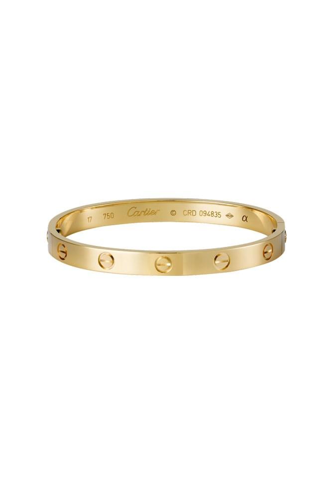"""<a href=""""http://www.au.cartier.com/en-au/collections/jewelry/collections/love/bracelets/b6035517-love-bracelet.html"""">18K Yellow-Gold 'Love' Bracelet, $8,800, Cartier</a>"""