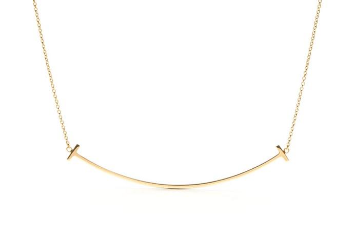 "<a href=""http://www.tiffany.com.au/jewelry/necklaces-pendants/tiffany-t-smile-pendant-36201525"">18K Gold 'Smile Pendant' Necklace, $1,550, Tiffany & Co.</a>"