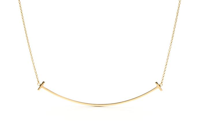 "<a href=""http://www.tiffany.com.au/jewelry/necklaces-pendants/tiffany-t-smile-pendant-36201525"">18K Gold 'Smile Pendant' Necklace, $1,550, Tiffany & Co.</a>"