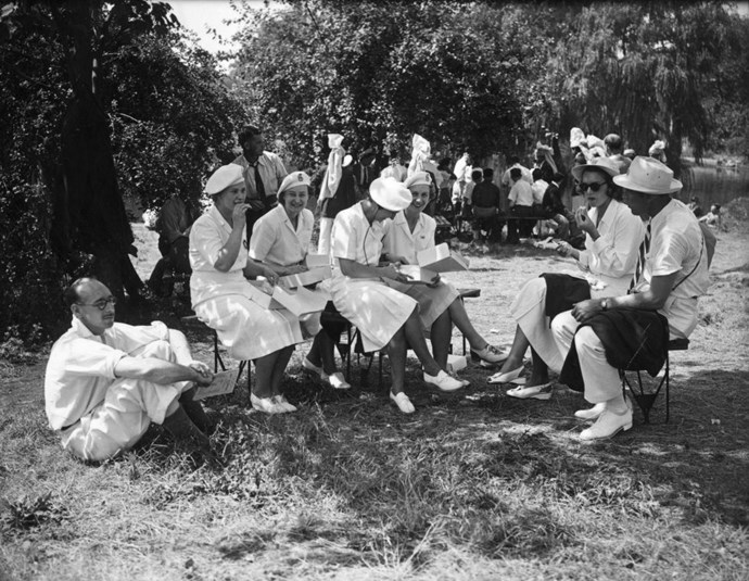 <p> <strong>1948</strong><p> <p> British Olympic women's fencing team having lunch on the lawn prior to the opening ceremony of the 1948 London Olympics. The A-line skirt becomes popular for women's female uniforms.