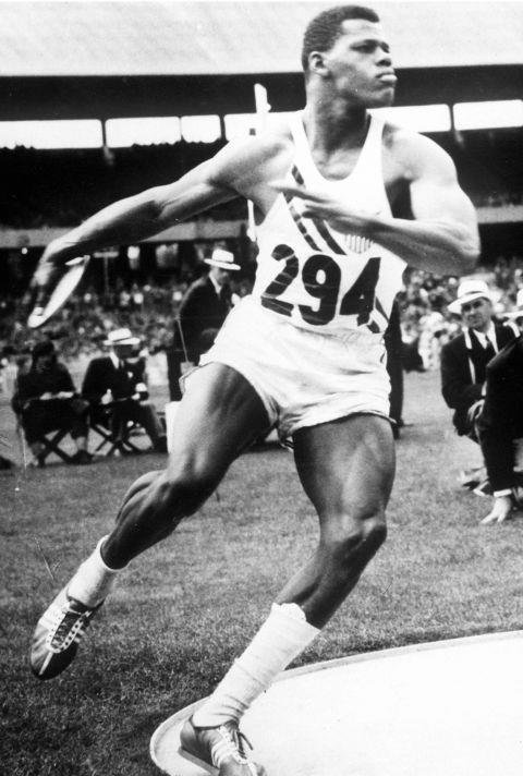 <p> <strong>1956</strong><p> <P> USA's Milton Campbell throwing a discus in the men's decathlon.