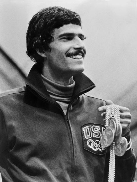 <p> <strong>1972</strong><p> <p> U.S. swimming champion Mark Spitz displaying a winning grin with five of his seven Olympic gold medals during the Munich Olympic Games.