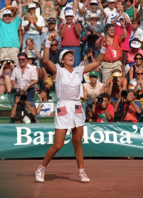 <p> <strong>1992</strong><p> <p> American tennis player Jennifer Capriati celebrates a win against German player Steffi Graf in the women's final at the Olympics in Barcelona.