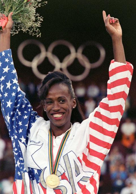 <p> <strong>1992</strong><p> <p> U.S. heptathlon athlete Jackie Joyner-Kersee is all smiles when she celebrates her gold medal at the Barcelona games.