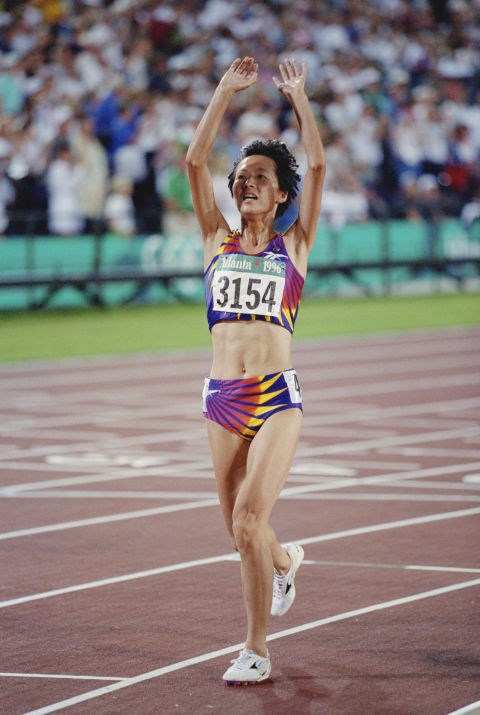 <p> <strong>1996</strong><p> <p> Chinese long-distance runner Wang Junxia celebrates her win at the women's 5000 meter event in Atlanta, Georgia.