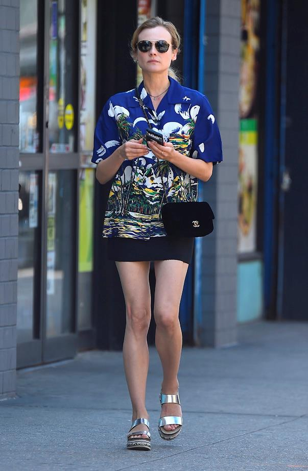 In an oversized Hawaiian shirt while walking in New York.