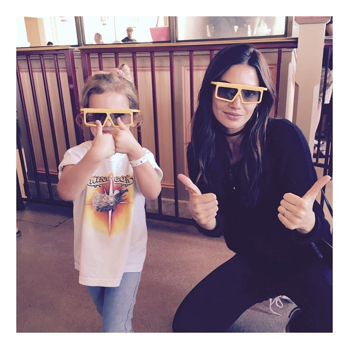 They're with the band (her little KoL tee!)