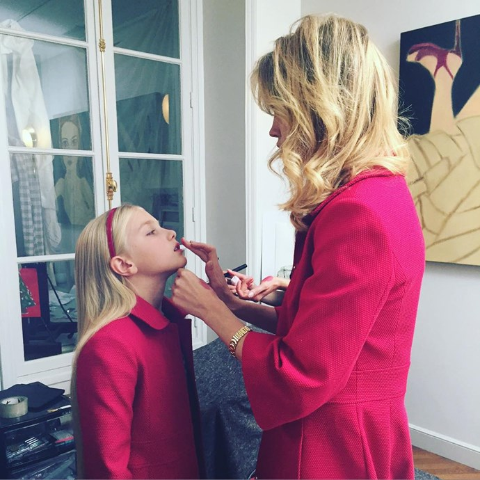 Natalia Vodianova and daughter Neva Portman don matching coats and lipstick.