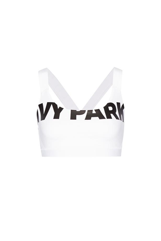 """Sports bra, $45, <a href=""""https://www.net-a-porter.com/au/en/product/716481/ivy_park/printed-stretch-jersey-and-mesh-sports-bra"""">Ivy Park at net-a-porter.com</a>."""