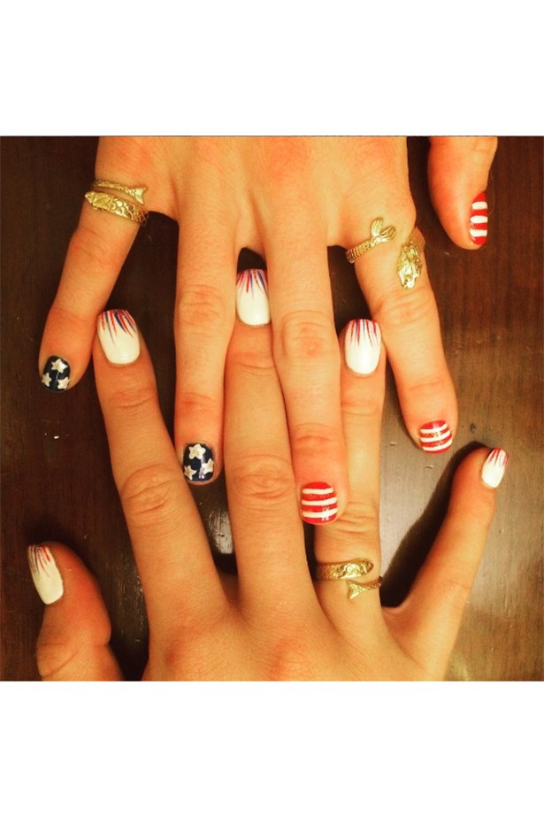 <strong>Missy Franklin and Cierra Runge, swimming, USA</strong><br> Nail art is a team effort.